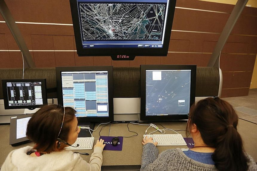 Air traffic controllers at the Singapore Air Traffic Control Centre. Apart from the recruitment drive, CAAS is reviewing processes and procedures, in line with a global ICAO initiative, to reduce fatigue among the staff.