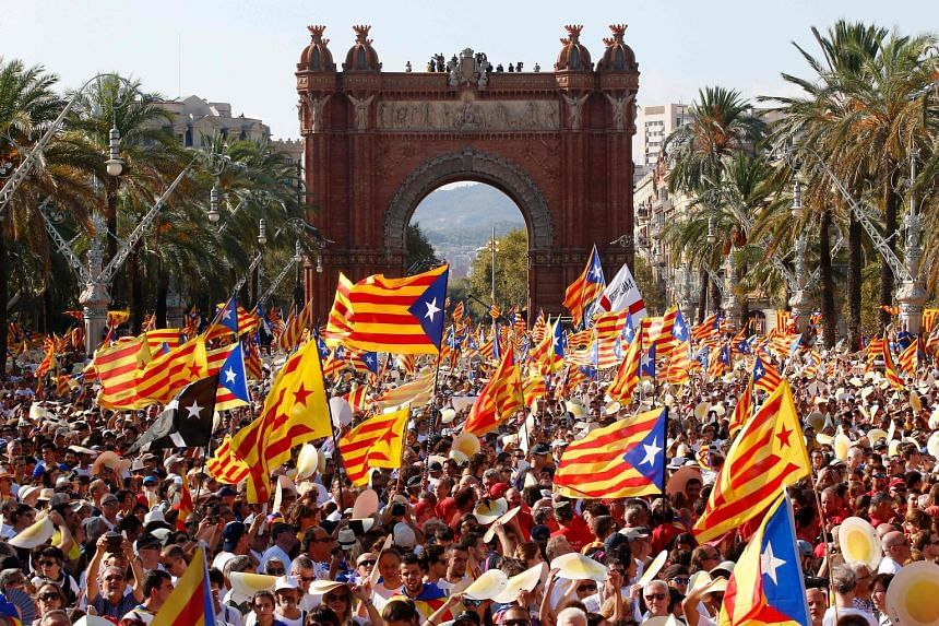 """Crowds waving pro-independence Catalan flags during a demonstration in Barcelona on Sunday, which is the region's national day known as """"Diada""""."""