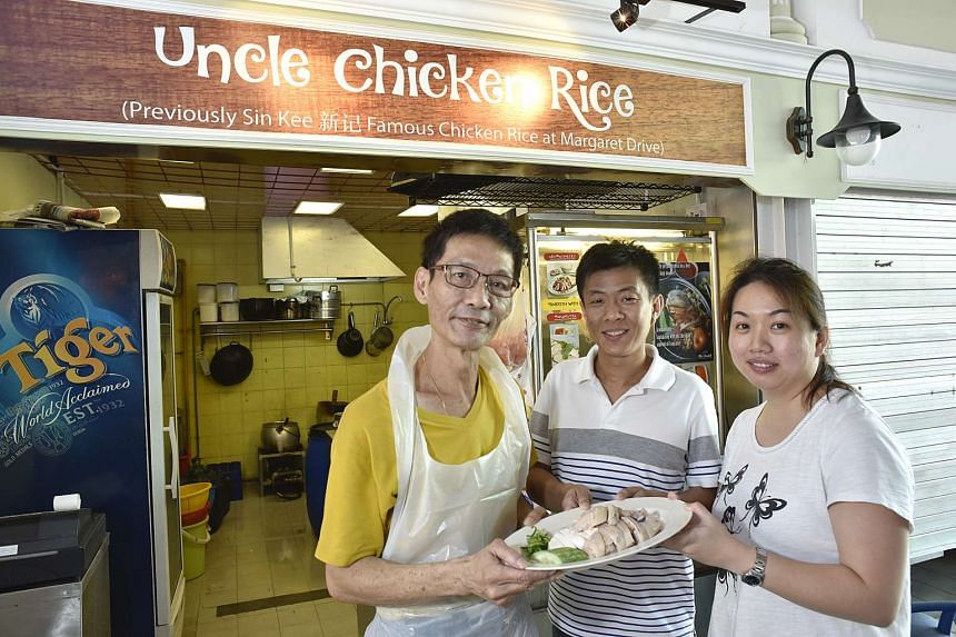 Mr Niven Leong (left) with the two people he sold his father's chicken rice recipe to: safety officer Koh Teng Loke (centre) and IT consultant Cheong Wai Fong.
