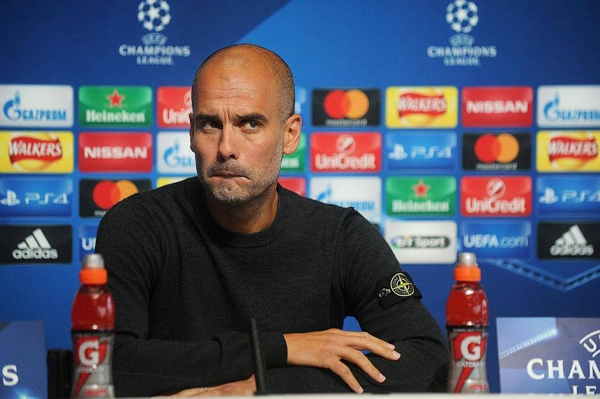 Manchester City manager Pep Guardiola reacts during a press conference at the City Academy in Manchester, Britain, on Sept 12, 2016. He says Manchester City are not yet ready to compete with Europe's elite.