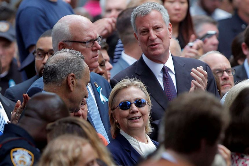 Clinton and New York Mayor Bill de Blasio (right) attend ceremonies to mark the 15th anniversary of the Sept 11 attacks.