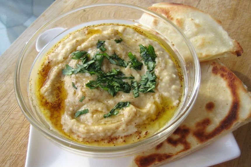 A file photo of a bowl of hummus. Israeli authorities have launched a search for 8 Chinese tourists to find out why they were charged more than US$4,000 (S$5,444) at a well-known Israeli hummus restaurant last week.