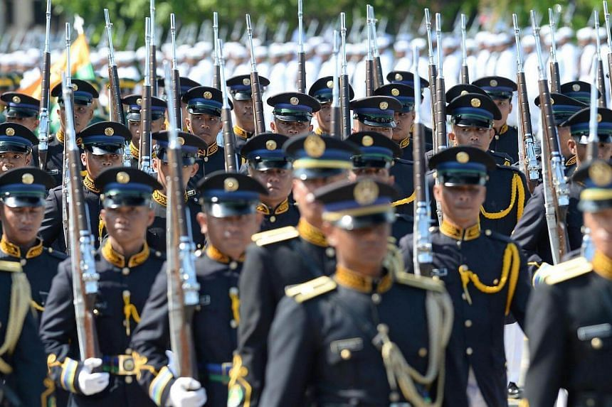 Philippine military personnel marching during a parade in honour of President Rodrigo Duterte at the military headquarters in Manila on July 1, 2016.