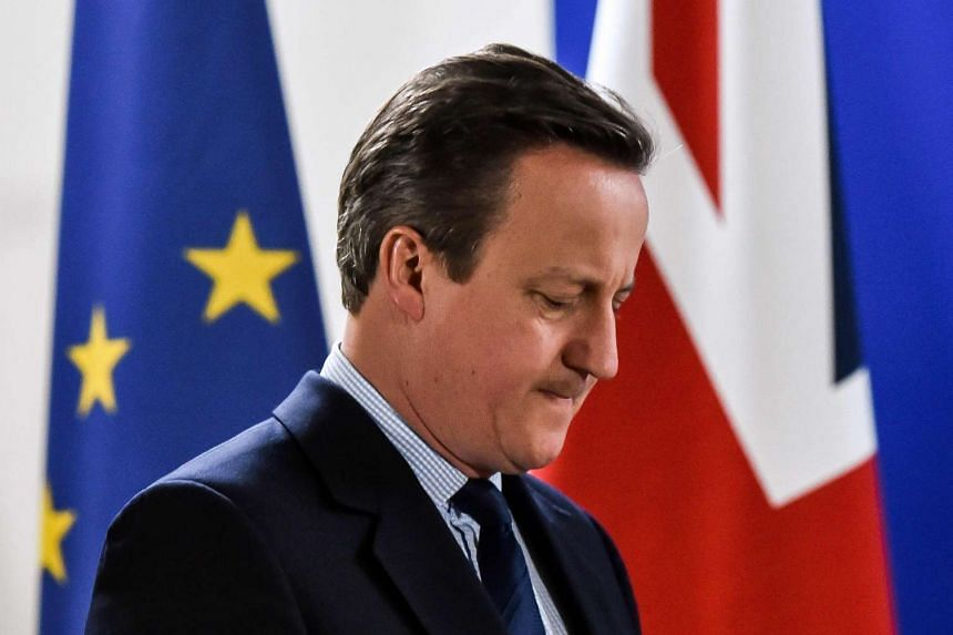 British Prime minister David Cameron arrives for a press conference during a European Union summit at the EU headquarters in Brussels  on June 28, 2016.