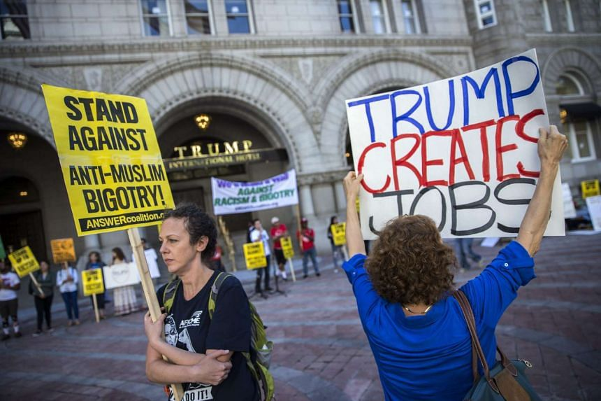 Pro and Anti Trump protesters rally in front of the Trump International Hotel on Pennsylvania Avenue in Washington, DC, on Monday (Sept 12).