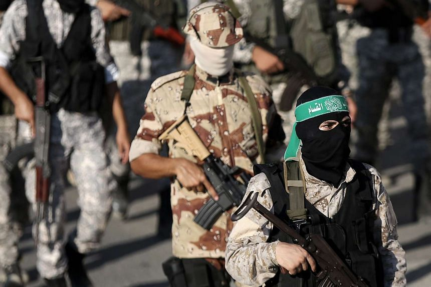 Fighters of the Ezz Al-Din Al Qassam Brigades, the armed wing of the Palestinian Hamas movement, march during a military parade in Gaza City on Saturday (Sept 10).