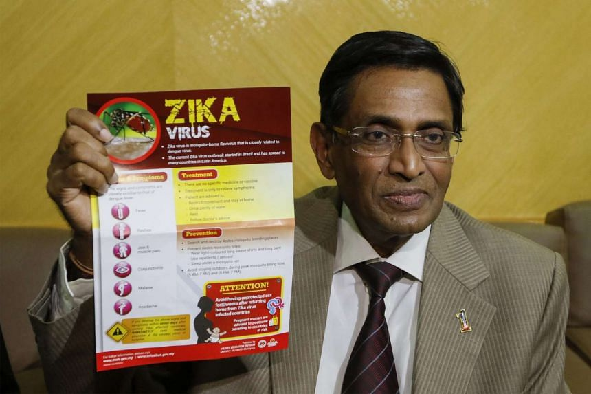 Malaysia's Health Minister Dr Subramaniam Sathasivam shows a Zika awareness campaign poster during a press conference in Putrajaya on Sept 14, 2016.