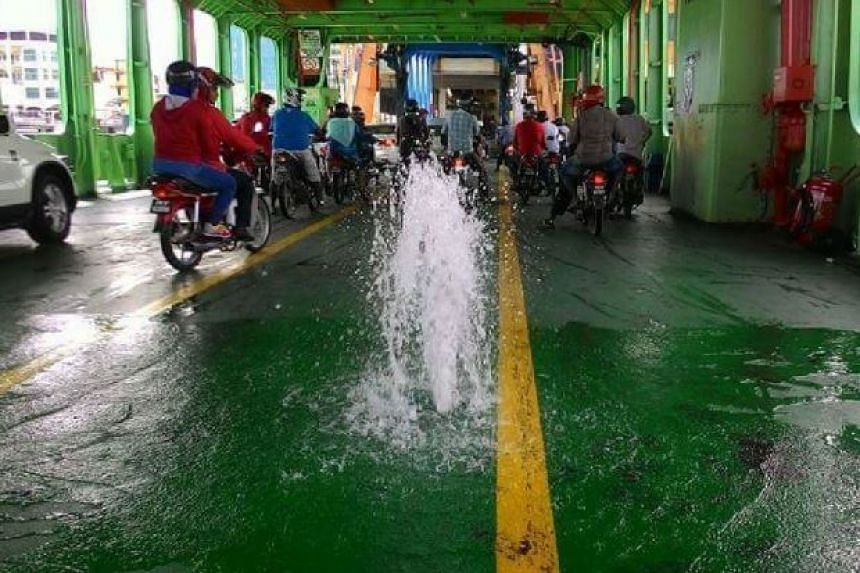 Motorists on board a ferry to Penang island had a scare when water started gushing out onto the deck.