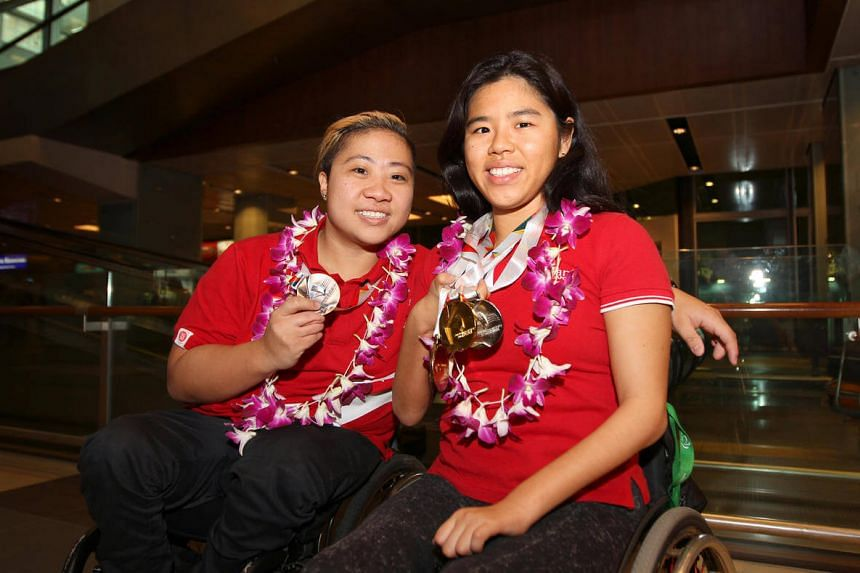 National para-swimmers Theresa Goh (left) and Yip Pin Xiu, with their medals won at the International Paralympics Committee Swimming European Open Championships 2016, at Changi Airport Terminal 1 on May 9.