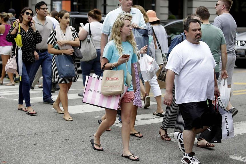 Shoppers along Michigan Avenue in Chicago, Illinois, on July 29, 2016.