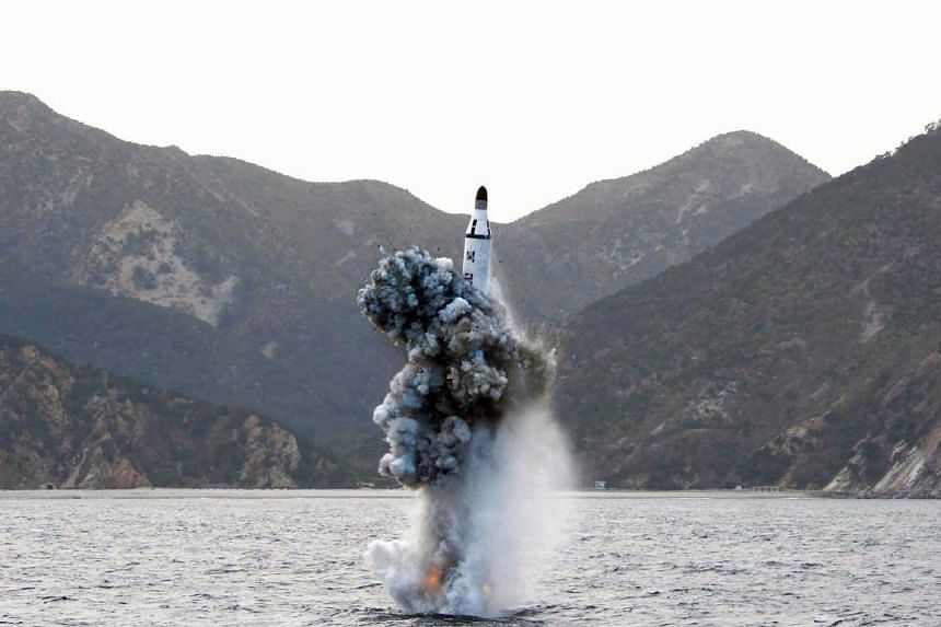 A file photograph showing an underwater test-fire of a strategic submarine ballistic missile at an undisclosed location in North Korea on April 23, 2016.