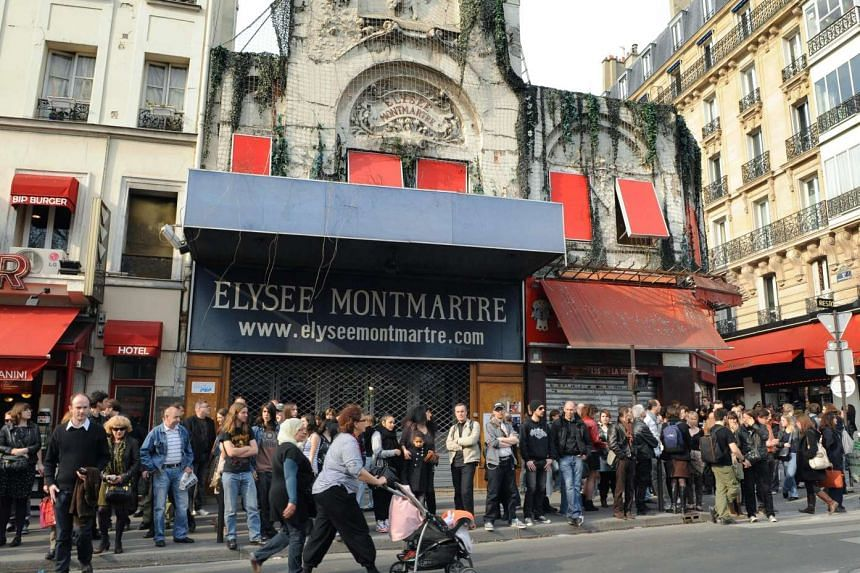 People gathering in front of the Elysee Montmartre music hall in Paris.