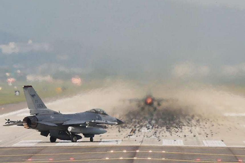 Two US F-16 fighters taking off from Osan Air Base in Pyeongtaek, South Korea, on Sept 13, 2016.