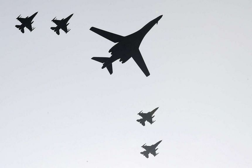 One of two B-1B Lancer bombers (centre) deployed by the US military and four South Korean F-15K fighters fly over Osan Air Base in Pyeongtaek, South Korea, on Sept 13, 2016.