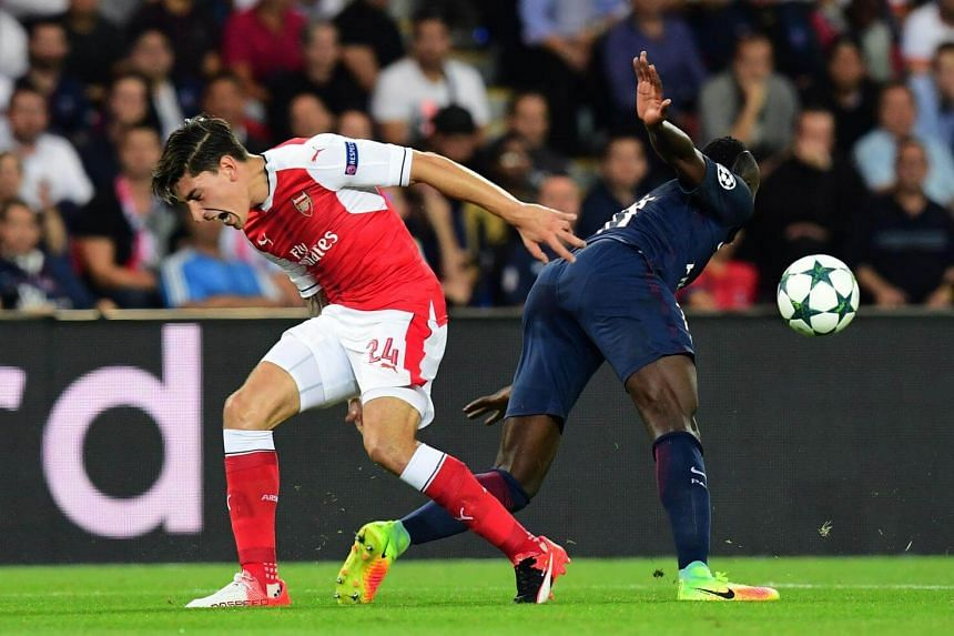 Arsenal's Spanish defender Hector Bellerin (left) vies with Paris Saint-Germain's French midfielder Blaise Matuidi during the UEFA Champions League Group A football match between Paris-Saint-Germain vs Arsenal FC, on Sept 13, 2016 at the Parc des Pri