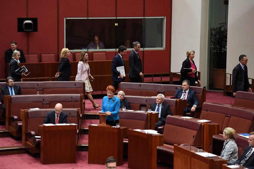 Green Party senators walking out as Australia's One Nation party leader Senator Pauline Hanson makes her maiden speech in the Senate at Parliament House in Canberra, Australia, Sept 14, 2016.