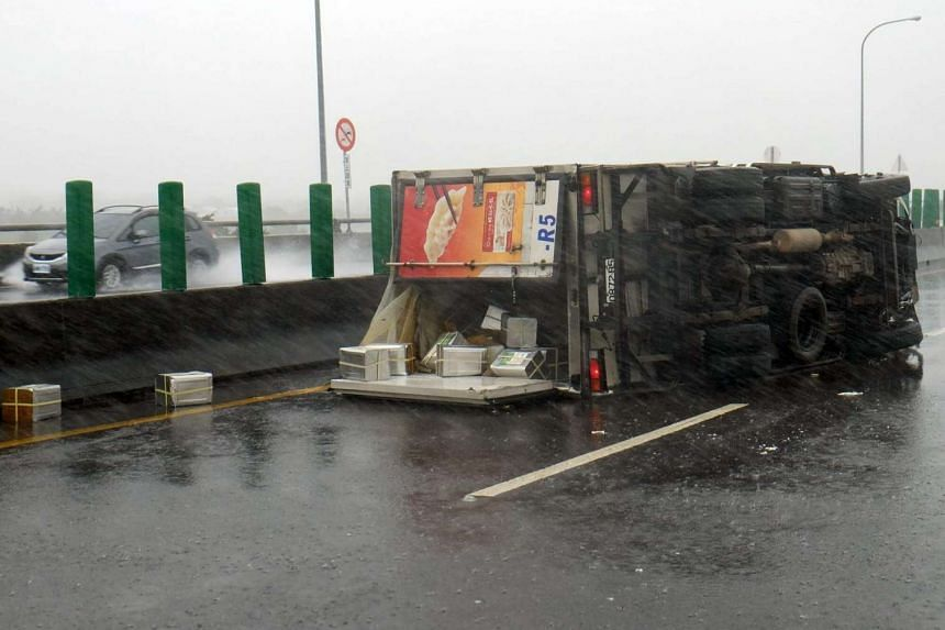 A truck is overturned due to the typhoon.