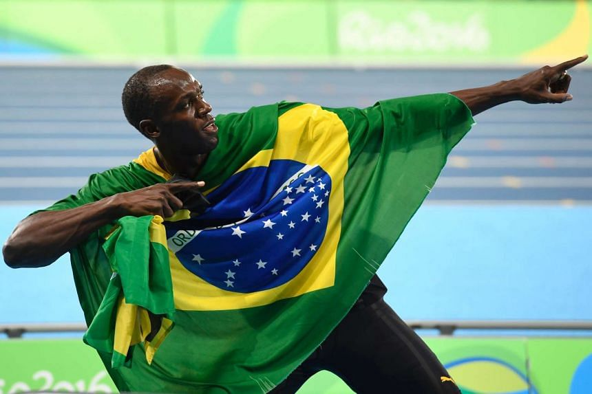 Jamaica's Usain Bolt celebrates his team's victory at the end of the Men's 4x100m Relay Final during the athletics event at the Rio 2016 Olympic Games on Aug 19, 2016.