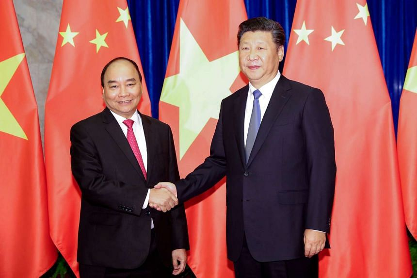 Chinese President Xi Jinping (right) shakes hands with Vietnam's Prime Minister Nguyen Xuan Phuc at Great Hall of the People in Beijing, China on Sept 13, 2016.