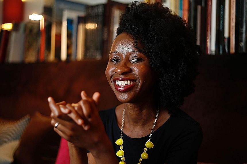 Imbolo Mbue (above) wrote Behold The Dreamers on the kitchen table of her tiny New York apartment while breastfeeding her babies.