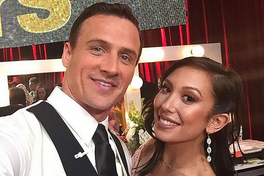 """Swimmer Ryan Lochte said he was """"a little hurt"""" while his partner, professional dancer Cheryl Burke, was in tears after protesters stormed the dance floor."""
