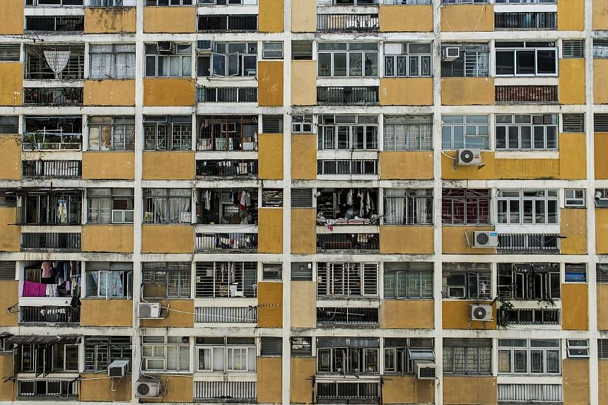 A residential building at a public housing estate in the Shek Kip Mei district in New Kowloon. Hong Kong Chief Executive Leung Chun Ying says there is no scaling down of a public housing project in the New Territories.