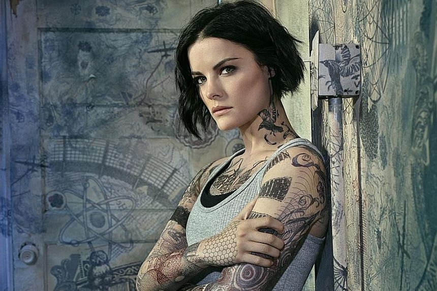 Actress Jaimie Alexander, playing Jane Doe (left), is set to deliver an action-packed new season of Blindspot.