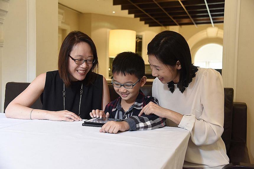 """Ms Chua (left), a big believer of children learning through play, put a """"six-figure sum"""" of her own money into developing DetecThink. Madam Ang (right) said the game appeals to her son Ethan, who has been playing the game and has completed it several"""