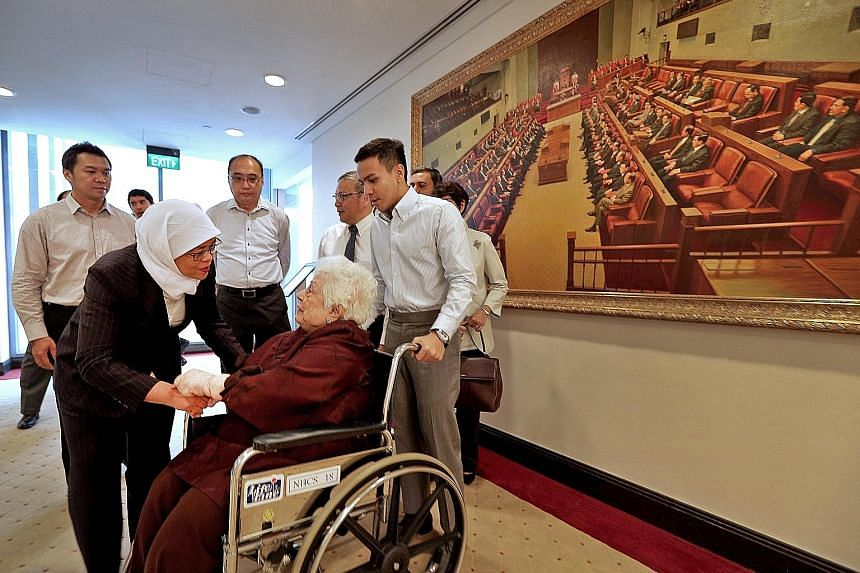 Speaker of the House Halimah Yacob talking to Madam Urmila Nandey, former president S R Nathan's widow, at Parliament House yesterday. Behind them are (from left) Mr Nathan's former special assistants Henry Goh and Desmond Yong, son-in-law Cheong Gay