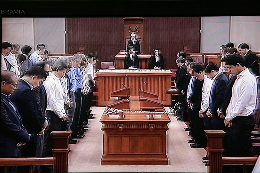 An image taken off television showing Parliament observing a minute of silence in honour of Mr Nathan who died on Aug 22. Nine members of the House rose to pay tribute to the former president. Also present were Mr Nathan's wife Urmila, children Juthi