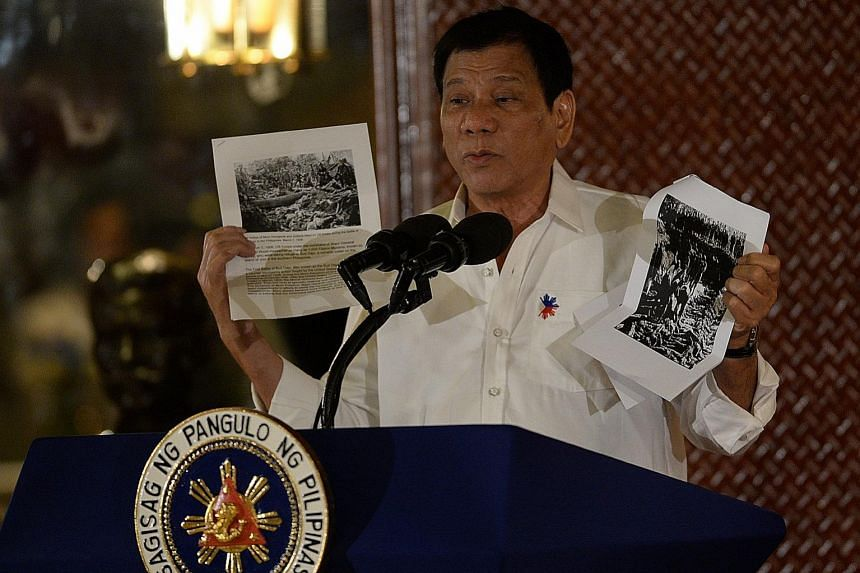 """Mr Duterte speaking about the US occupation of the Philippines in the early 1900s in Manila on Monday. """"We are not going to cut our umbilical cord to countries we are allied with,"""" he said at an air force event yesterday."""
