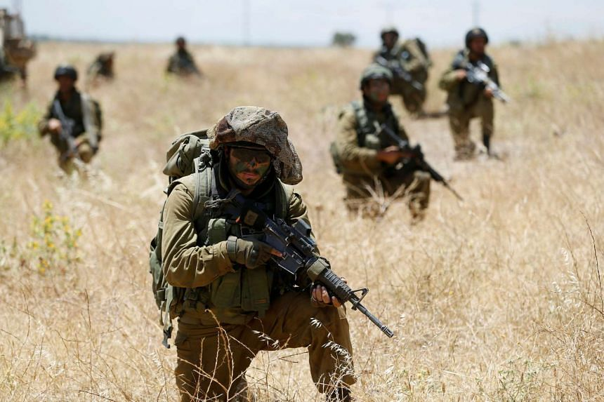 Israeli soldiers from the 605 Combat Engineering Corps battalion take part in a training session in the Israeli-occupied Golan Heights at the border with Syria.