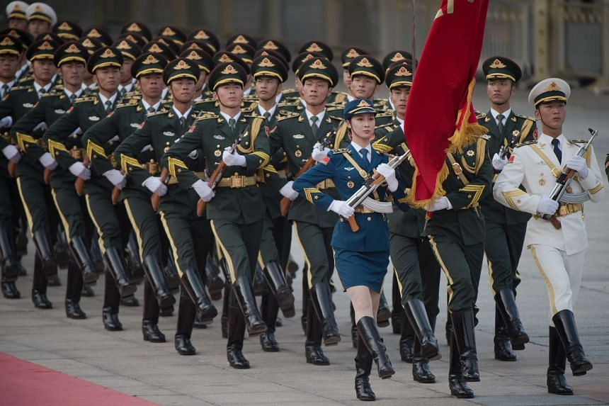A military honour guard marches in formation during a welcoming ceremony for Vietnam's prime minister in Beijing on Sept 12, 2016.