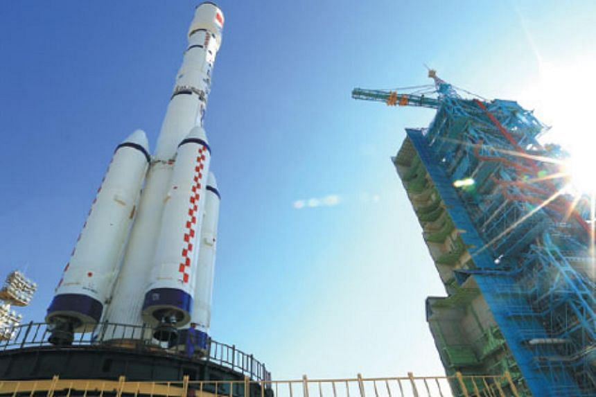 China's Tiangong 2 space lab, aboard the CZ-2F rocket carrier, being transferred to the launch pad at the Jiuquan Satellite Launch Centre in Gansu province on Sept 9, 2016.