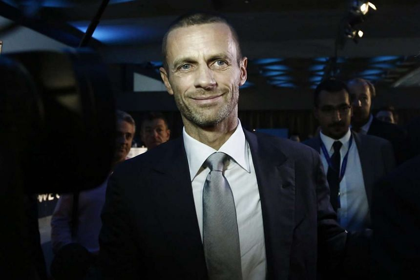 Aleksander Ceferin (centre) reacts after he was elected as the new UEFA President at 12th Extraordinary UEFA Congress in Athens on Sept 14, 2016.