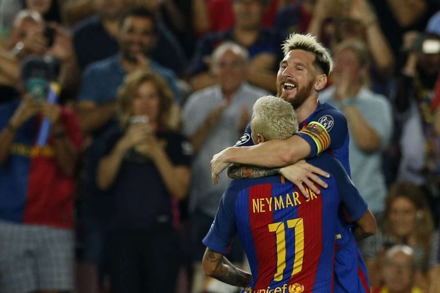 Barcelona's Lionel Messi celebrates scoring their second goal with Neymar.