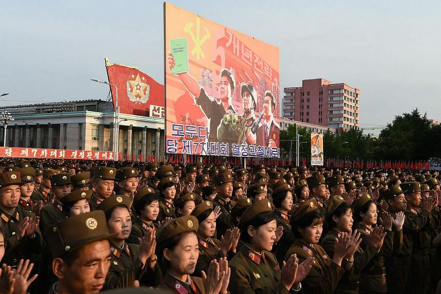 Soldiers applaud during a celebration rally n Kim Il Sung Square in Pyongyang on Sept 13, 2016, following the country's successful test of a nuclear warhead.