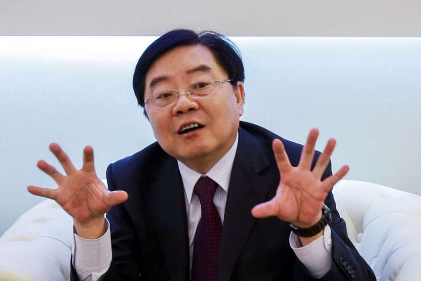 Xu Jianyi, chairman of FAW Group Corp, gestures as he attends an event in Shanghai.