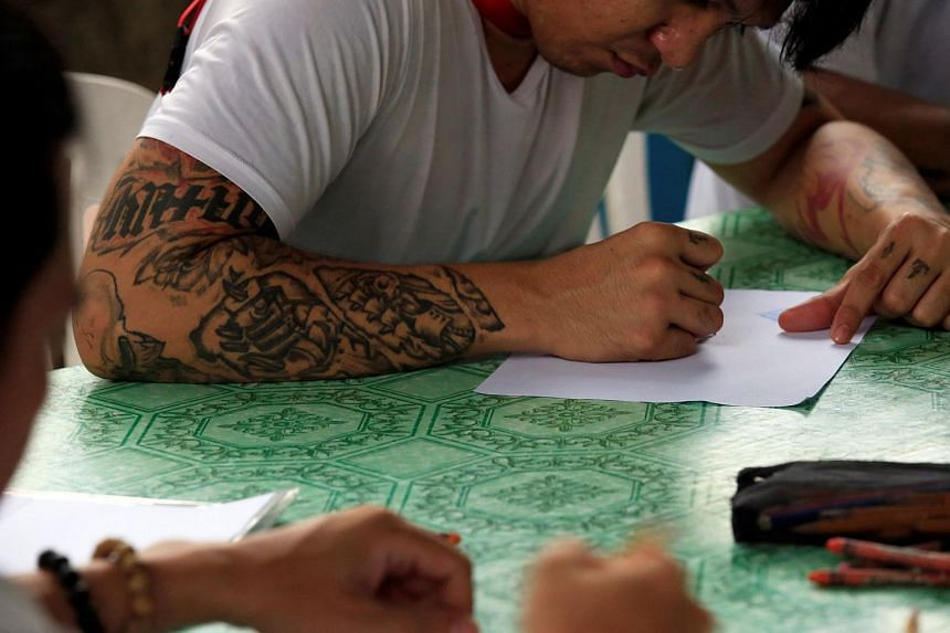 Drug users undergoing rehabilitation draw during art therapy at a Centre for Christian Recovery drug rehabilitation center in Antipolo city, Philippines on Sept 12, 2016.