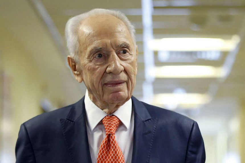 Former Israeli president Shimon Peres delivers a statement to the media as he is discharged from a hospital near Tel Aviv on Jan 19, 2016.