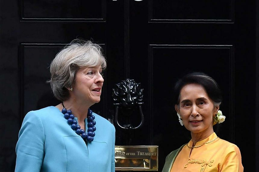 Aung San Suu Kyi is greeted on the steps of 10 Downing Street in London by British PM Theresa May.