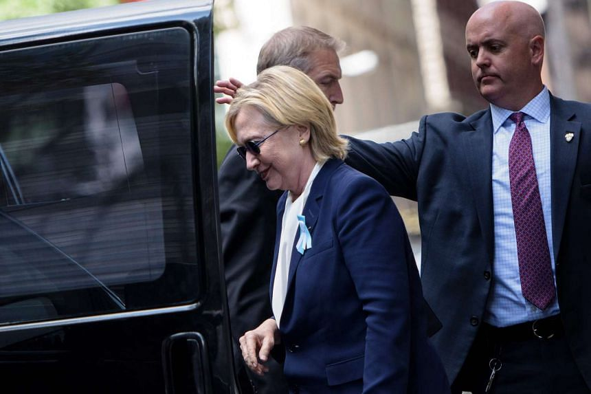 Hillary Clinton gets in her car while leaving her daughter's apartment building after resting on Sept 11, 2016, in New York.