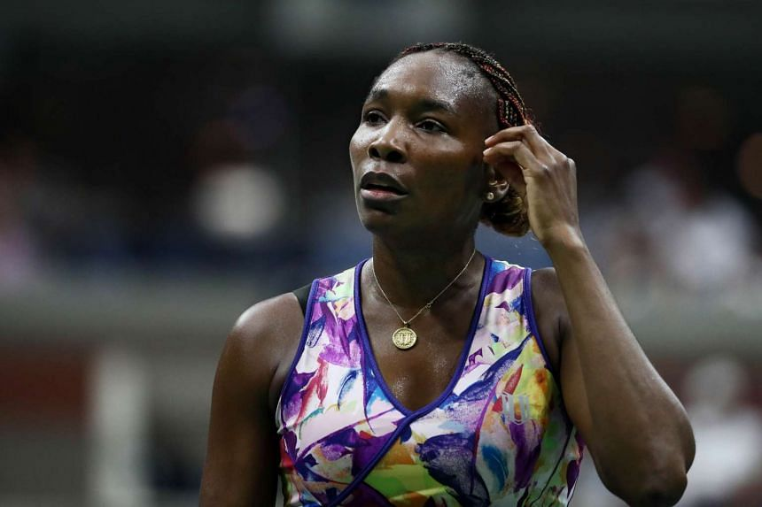 Venus Williams cools off between points against Julia Goerges during their 2016 US Open second round Women's Singles match.