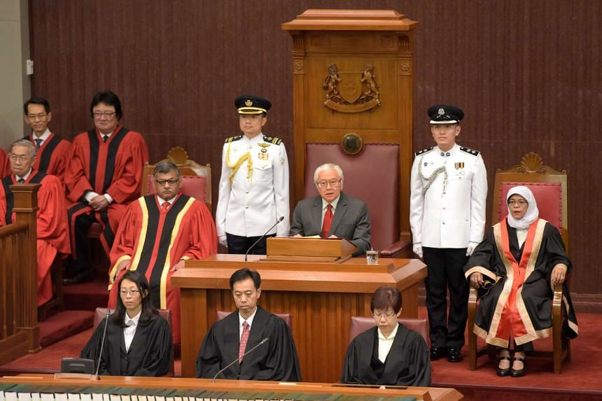 President Tony Tan Keng Yam opening the first session of the 13th Parliament, flanked by Chief Justice Sundaresh Menon (far left) and Speaker of Parliament Halimah Yacob on Jan 15, 2016.