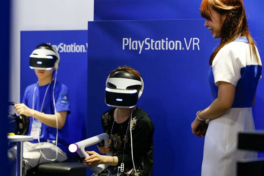 Visitors experience Sony PlayStation VR headsets during the 2016 Tokyo Game Show at Makuhari Messe Convention Center in Chiba prefecture, Japan on Sept 15, 2016.