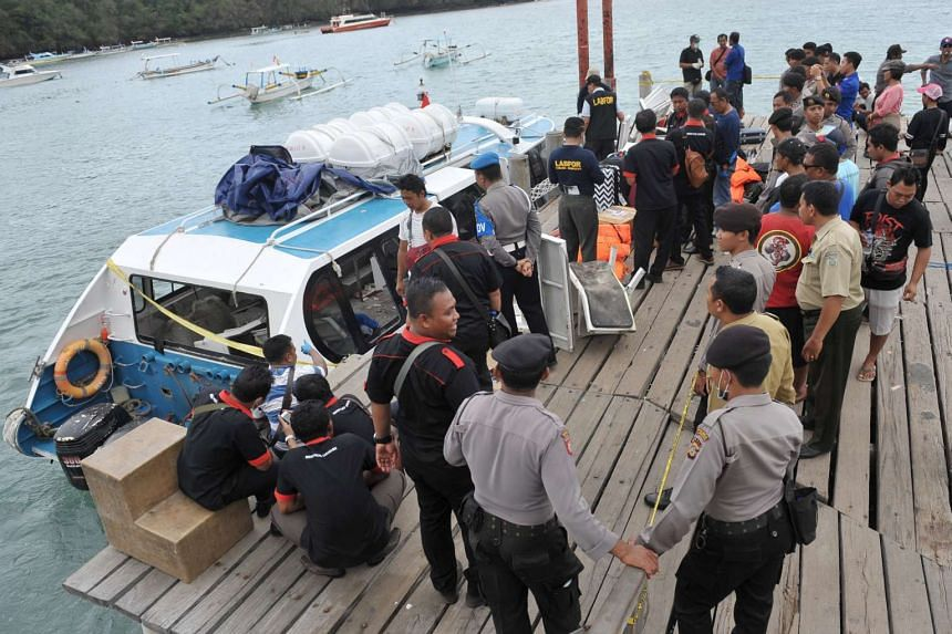 Police and investigators examine the ferry.