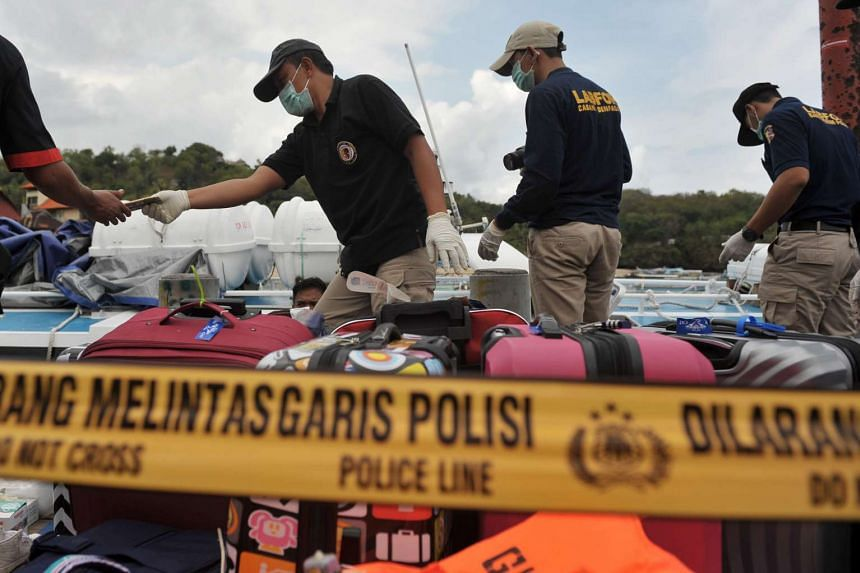 A police forensic team examine the ferry.