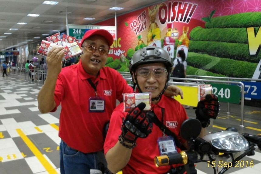 Mr Zaini Hamid (wearing helmet) and Mr Jamauludin Awang at the launch of the Towkay @ South West programme.