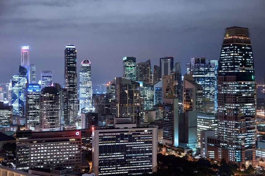 The Singapore Business District skyline at night.
