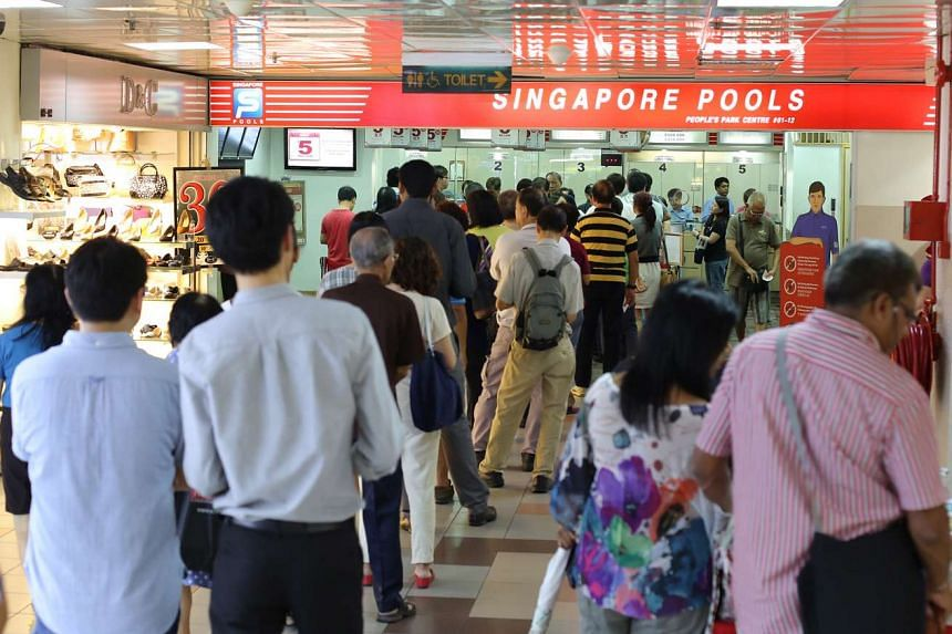 Punters queueing to buy tickets for the New Year Toto Draw at People's Park Centre.